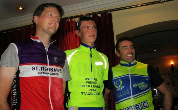 St. Tiernan's Fergal May and Lucan's John Caffrey flank league winner Sean McKenna on 2014 podium